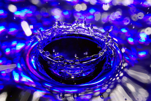 This was a pretty simple set up of a frame holding a softdrink bottle above a blue bowl of water. 2 small pinpricks in the bottom of the bottle provided a steady stream of drops and the on-board flash firing full and front-on was useful for once! All shots were manually fired, the drops were pretty consistent dropping every 2 or 3 seconds so no timer, sensor or remote triggering devices were needed. I took these shots as my local club has a 'water' theme for it's January meet.