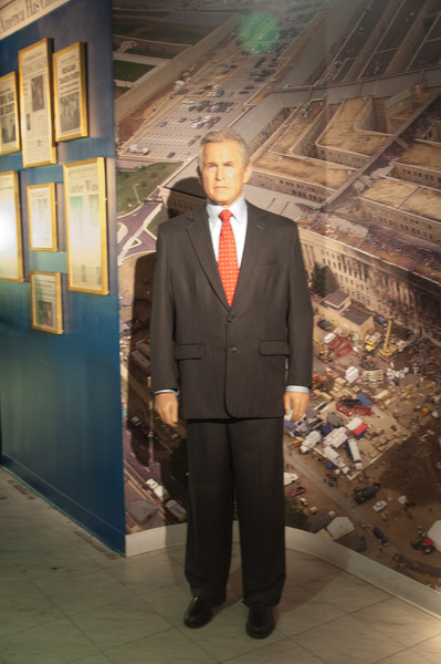 George W. Bush in front of a mural of the Pentagon on 9/11.