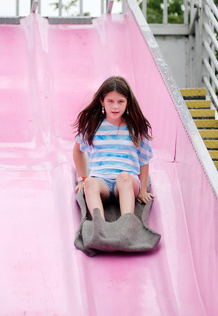 Hanna Reth, 12, slides down the Fun Slide during the 4-H Fair on Wednesday.