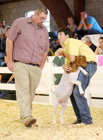 Garrett Lowes looks toward judge Craig Pearson during the goat portion of the competition.