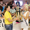 4-H Fair Queen Samantha Thurston presents Stephanie Morris with her Supreme Showman Trophy.