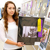 Tressia Phipps holds her winning cat portrait during the 4-H Fair on Thursday.