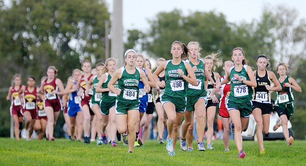 From left, Pendleton Heights runners Maddi Hinton, Emma Manchess, Chelsea Blackwell and Alex Buck lead at the start of the Madison County Cross Country meet at Pendleton Heights on Tuesday.