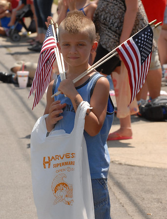 A youngster shows his patriotism at the Fourth of July parade.