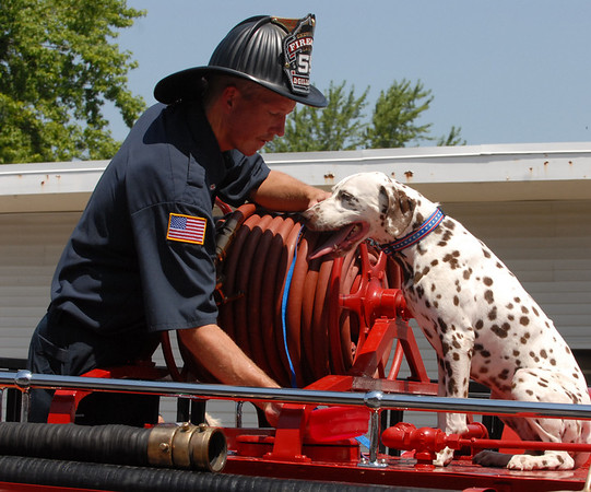 A fireman and the department mascot.