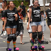 Roller Derby girls skate down Main Street at the parade.