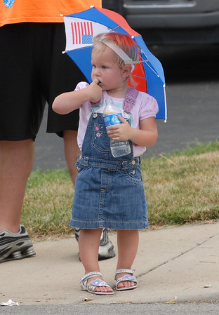 A youngster watches a float roll by at the Chesterfield Fourth of July Parade. Hundreds of people attended the popular holiday event despite the sweltering heat.