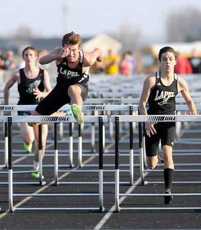 Don Knight | The Herald Bulletin<br /> Lapel's Noah Hendershot clears the last hurdle in first place.