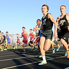 Don Knight | The Herald Bulletin<br /> From right, Anderson's Jason Kabir, Lapel's Logan Bradley and Pendleton Heights' Eli Young take off at the start of the boy's 1600 meter run.