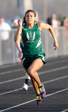 Don Knight   The Herald Bulletin<br /> Pendleton Heights' Kiawna Cottrell wins the girls 100 meter dash.