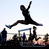 Don Knight | The Herald Bulletin<br /> Lapel's Paige Hendershot leaps over a hurdle during the girls 300 meter hurdles as she is silhouetted by the evening sky during the Madison County track meet at Madison-Grant High School on Friday.