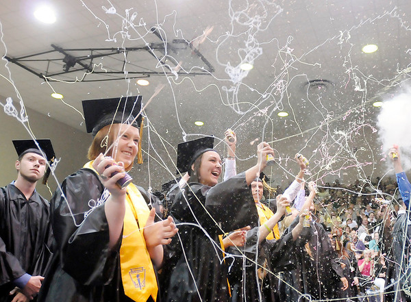 Madison-Grant students celebrate their graduation with Silly String on Saturday. Madison-Grant's Class of 2013 included 102 students.