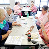 Don Knight | The Herald Bulletin<br /> Clockwise from left, Mardel McKay, Phyllis Downham, Juanita Crisp and Barbara Pickel play Mexican Chain Dominoes at the Community Hospital Anderson Education Building on Monday.
