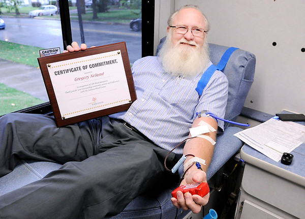 Don Knight   The Herald Bulletin<br /> Greg Noland receives recogniztion from the Indiana Blood Center as he makes his 100th blood donation on Wednesday.