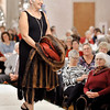 "John P. Cleary |  The Herald Bulletin<br /> Model Karen Bucci walks the runway during the Gruenewald Historic House ""Little Black Dress"" style show & luncheon at the Paramount Ballroom Tuesday as part of the Festival of Trees."