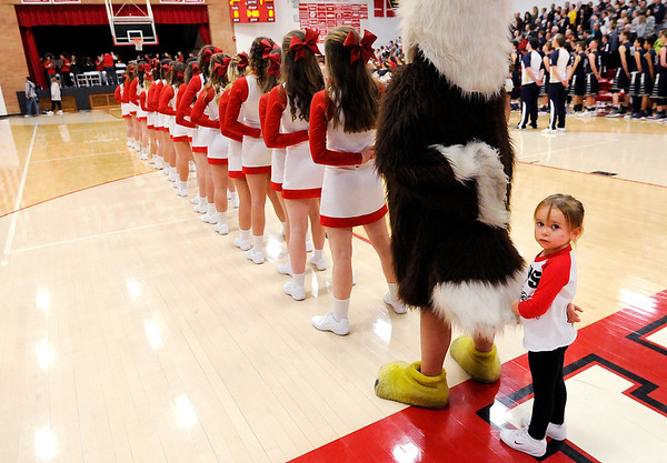 Don Knight |  The Herald Bulletin<br /> A young fan joins the Frankton cheer leaders during the national anthem as the Eagles hosted Oak Hill.