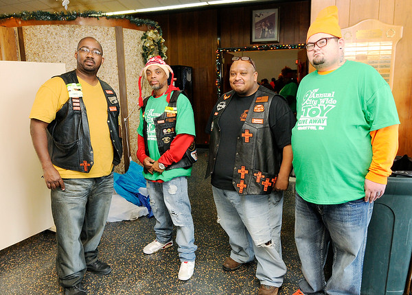 Don Knight |  The Herald Bulletin<br /> Brothers of the Wheel Motorcycle Club volunteers greet families to the City Wide Toy Giveaway. From left are Blue Smoke, Smitty, National President Big Baby and Mayo.