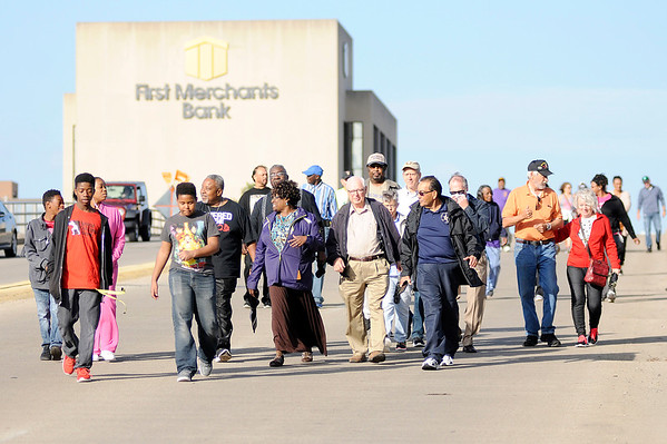 Don Knight | The Herald Bulletin<br /> Participants in the Reconciliation March walk across the  Eisenhower Bridge on Saturday. The march came about when the Rev. Anthony Harris of Church Upon the Rock had a dream of a march to bring the entire community together.