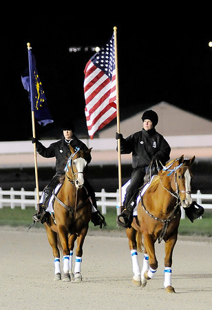 Don Knight   The Herald Bulletin<br /> Hoosier Park outriders carry the American and Indiana flags as the lead the first post parade for the Breeders Crown at Hoosier Park on Saturday.