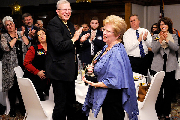 Don Knight |  The Herald Bulletin<br /> Sally Devoe receives a standing ovation after accepting the Athena award on Thursday.