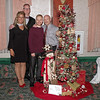 "Mark Maynard | for The Herald Bulletin<br /> Sponsors Sarah and Eric Ward of Indianapolis were on hand with Jacob and Carey Cook at the Festival of the Trees Gala for the auction of their ""A Wonderland Christmas"" tree."