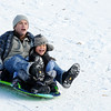 Don Knight |  The Herald Bulletin<br /> Bryan and Taylor Roscoe ride down the sledding hill at Shadyside on Saturday. Several families took advantage of the fresh snowfall on the holiday weekend <br /> to ride down the sledding hill.