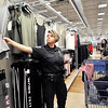 John P. Cleary |  The Herald Bulletin<br /> Anderson Police officer Heather McClain helps Aryss Perdue, 13, pick out clothes during Anderson FOP's annual Shop With A Cop program at Meijer's Tuesday morning.