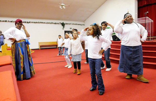 Don Knight    The Herald Bulletin<br /> Arnette Peak leads the King's Kids and King's Teens in a dance routine during the Mt. Pilgram Church Youth Christmas Program on Saturday.