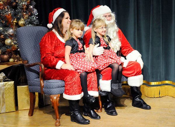 Don Knight |  The Herald Bulletin<br /> From left, Ivey and Lilly Andrews pose for a photo with Mr. and Mrs. Claus during Breakfast with Santa at the Paramount on Saturday. The event was a sellout with 350 tickets sold.