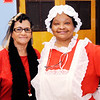 Don Knight |  The Herald Bulletin<br /> Demetrice Hudson as Mrs. Santa and Marilyn Goree volunteer at City Wide Toy Giveaway.