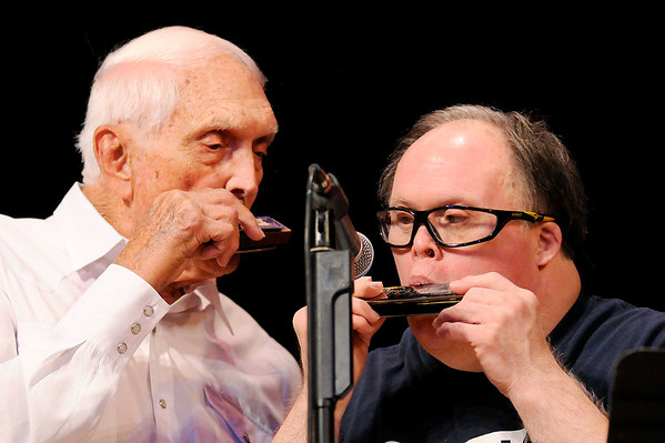 "Don Knight | The Herald Bulletin<br /> Carl Erskine and his son Jimmy perform ""Happy Birthday to You"" during the Little Bit Country Jamboree at the Paramount Theatre on Thursday. The Special Olympics raises most of its budget for Madison County through the benefit concert."