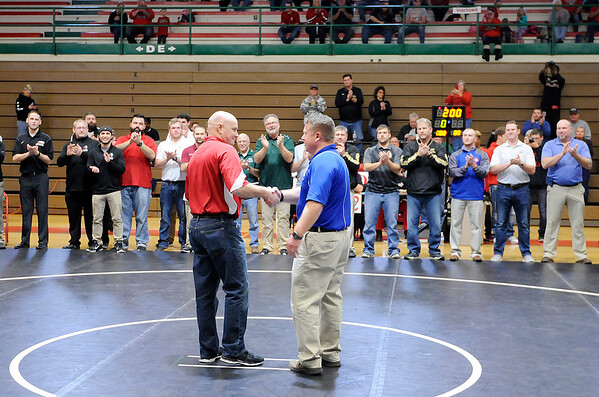 Don Knight    The Herald Bulletin<br /> Former Anderson wrestling coach Cary House is recognized for his contribution to the sport during the Madison County Wrestling Tournament at Anderson High School.