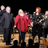 "Don Knight |  The Herald Bulletin<br /> Accompanied by the Alpha Brass, from left, Woody Wright, Martha Green and Cheryl Hardacre close out Madison County's Veterans Day Celebration with a performance of ""God Bless America"" at the Paramount on Thursday."