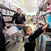 John P. Cleary |  The Herald Bulletin<br /> Kamora Walker, 7, is excited as she picks out items at the Elwood Kmart with the helps of Elwood firefighters Justin Austad and Zach Schrader Monday afternoon. The Fire Rescue House of Madison County, with the assistance of the Elwood Fire Department, donated money to give Kassandra Zachary's three children a chance to shop for clothing and toys this holiday season after their home was destroyed by fire in Elwood Nov. 30th.