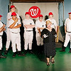"Mark Maynard | for The Herald Bulletin<br /> As the Washington Senators look on, reporter Gloria Thorpe (Kirby Gilliam) tests-out some nicknames for their new star player, Joe Hardy, in ""Damn Yankees"" presented by Anderson's Mainstage Theatre."