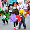 "John P. Cleary |  The Herald Bulletin<br /> Paisley Comer, 4, or ""Minnie Mouse"", walks down South Anderson Street with other parade goers during the Elwood Halloween parade Monday evening."