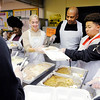 Don Knight |  The Herald Bulletin<br /> From left, Lauren Snyder, Henry Nave and Katelynn Simmons volunteer on the serving line during the Gospel Highlight Community Thanksgiving Dinner at the Geater Center on Thursday.