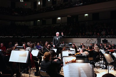 The generosity of long time Plymouth Philharmonic supporter Frank Tofoloni of the Pine Hills, earned him the honor of conducting the orchestra for one selection at the Holiday Pops concert. Wicked Local Photo/Denise Maccaferri