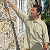 MITCH SHOWS THE BEAUTIFUL STONE SIDING ON A BUILDING.