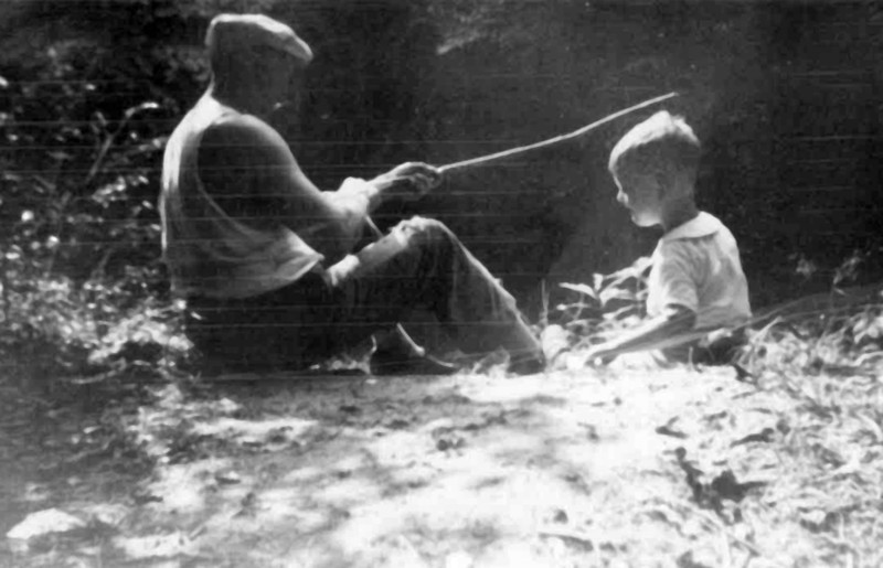 Oscar C. Main (left) fishing with his son Woodrow Main.