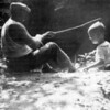 Oscar C. Main (left) fishing with his son Woodrow Main.