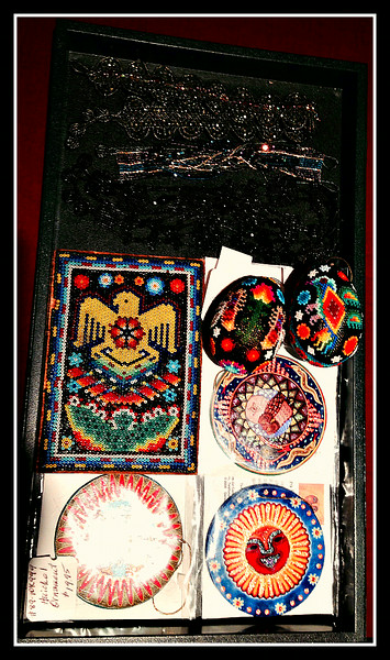 Tray #1 - Huichol - 3 round ornaments with symbolism explained - Eagle beaded plaque - black flower choker necklace with matching bracelet - Gold choker necklace - Gold & purple beaded strand bracelet -