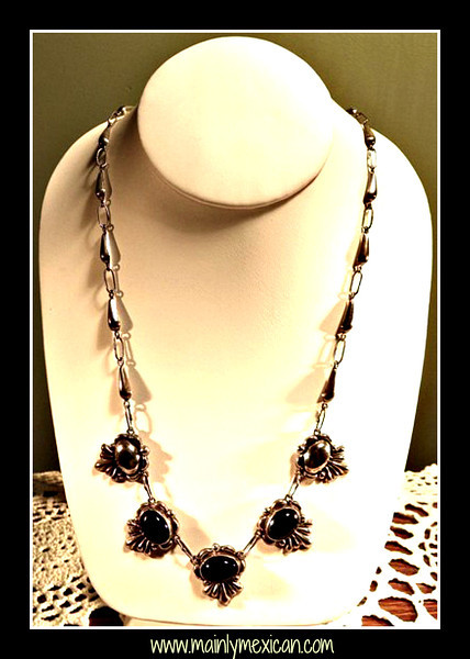 "J13f965913g - About 21"" long, this vintage black cabochon Onyx & sterling silver necklace is marked - 925 STERLING, MEXICO.  The three oval shaped onyx stones are about .75"" wide<br /> Necklace has a latch hook clasp and is in excellent condition - Price $125.00"
