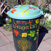 Use old garbage bins to store fall leaves. Leaves are used all year in the compost.