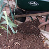 Add finished compost to garden beds to improve the soil.