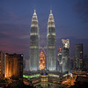 The Petronas Twin Towers at twiight from the SkyBar on the roof of Traders Hotel in KL, MALAYSIA