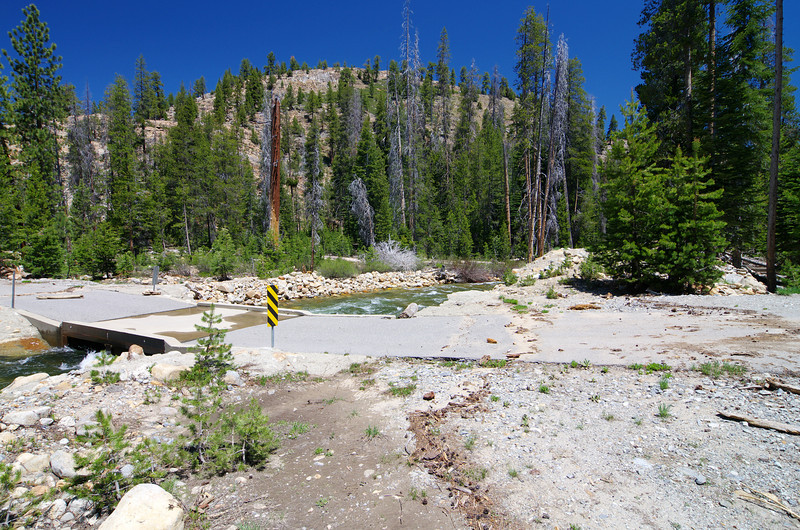 """How High did the water get over the bridge?  My guess is about 18""""-2' based on the Bark line on the road in the right of this picture and the log from the previous one."""