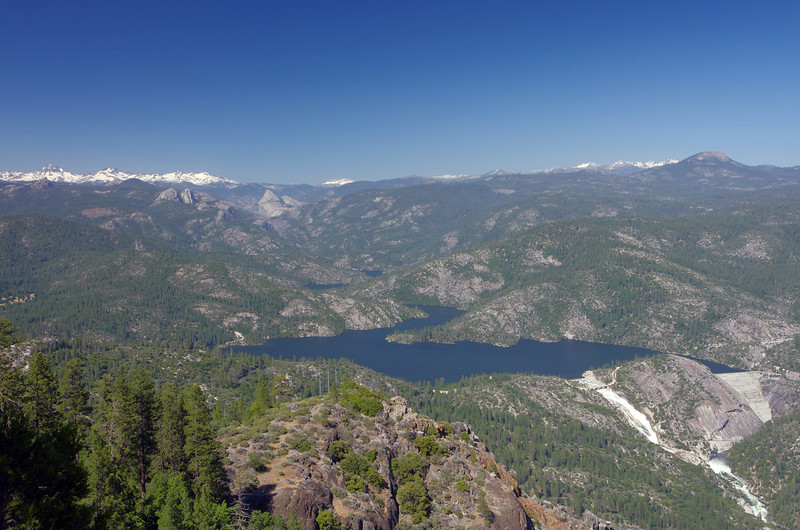 Taken from the Mile High Curve; Mammoth Pools @ 102% Capacity, Mammoth Mtn in the Middle of the picture towards the back, Mt Ritter and the Minnarets in the upper left of the photo, and Mt Tom in the upper right of the photo.