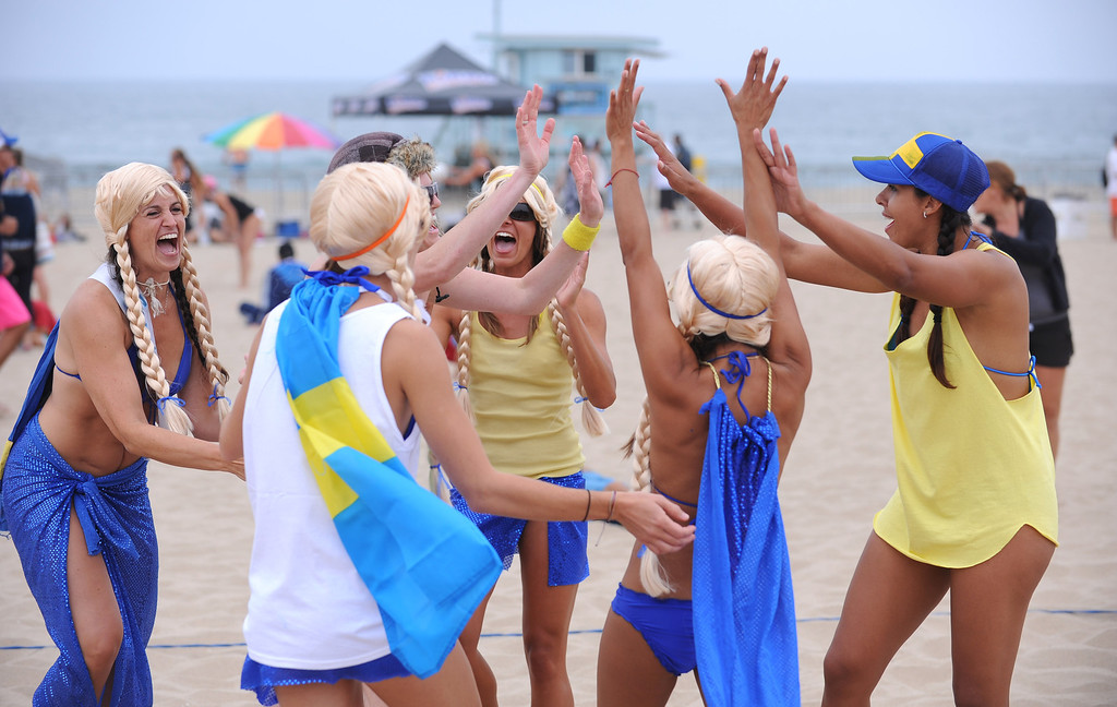. Super Swedes celebrate a point. Manhattan Beach Charlie Saikley 6-man beach volleyball tournament.   Photo by Brad Graverson 7-31-13