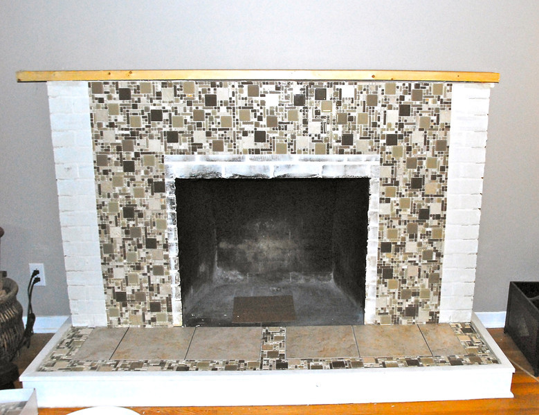 Then we started to put it back together, using a mix of ceramic and glass tile.